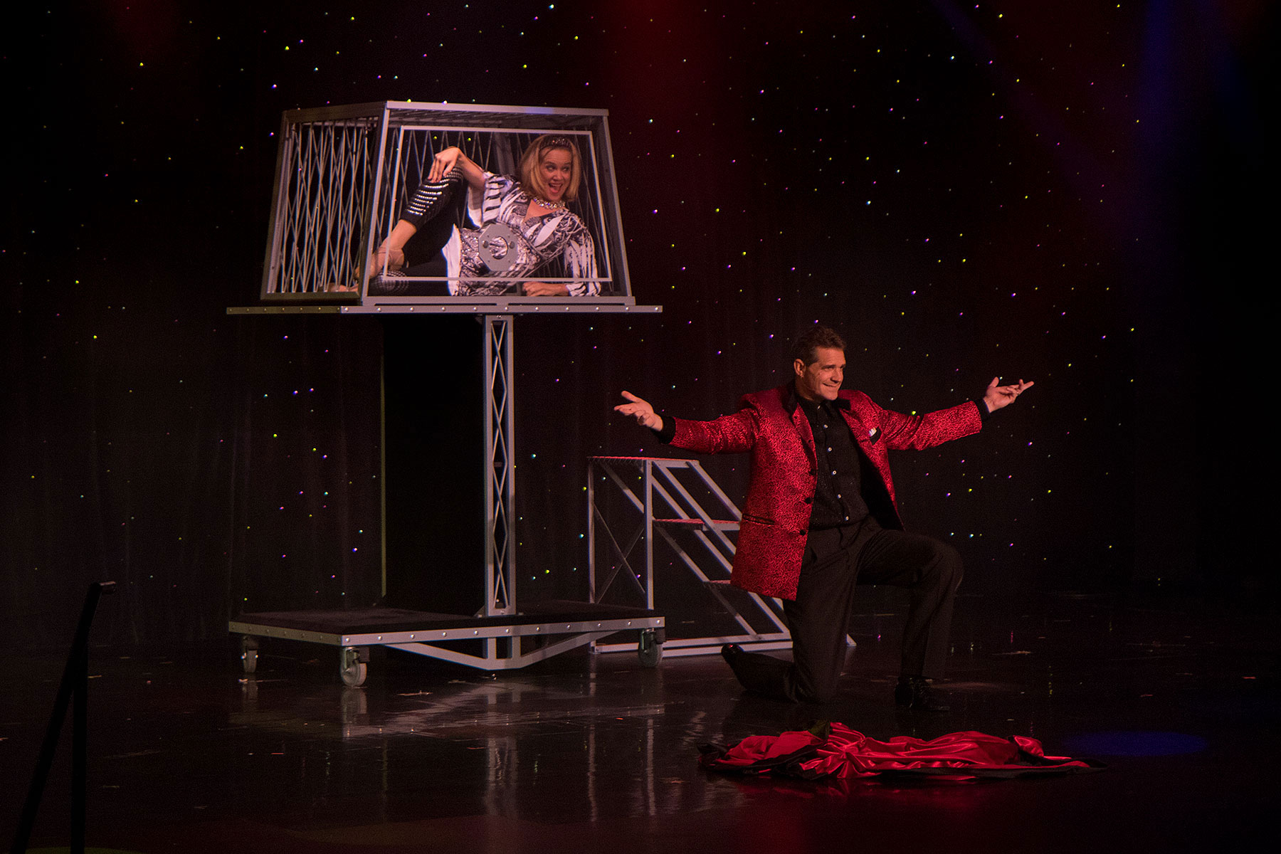 [Photo: Rick & Suzan Wilcox performing a grand illusion.]